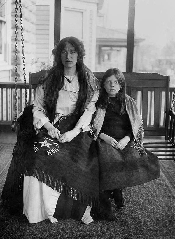 Titanic Survivors Charlotte Collyer and her 8-year-old daughter Marjorie after they finally made it to America. She has a White Star Line blanket on her lap. Their faces say it...things are never going to be the same.