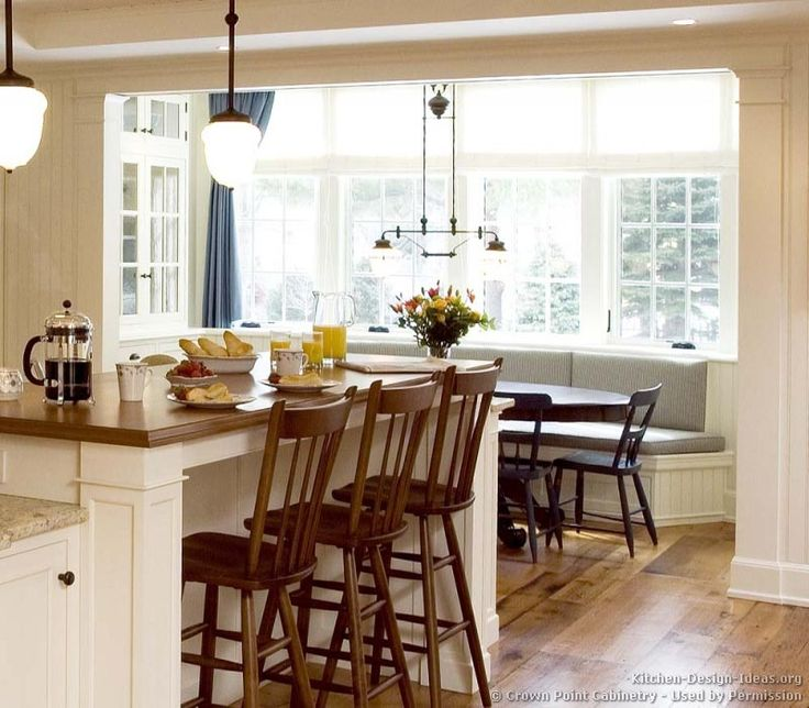 window seat / banquette along with a breakfast bar on the island ...