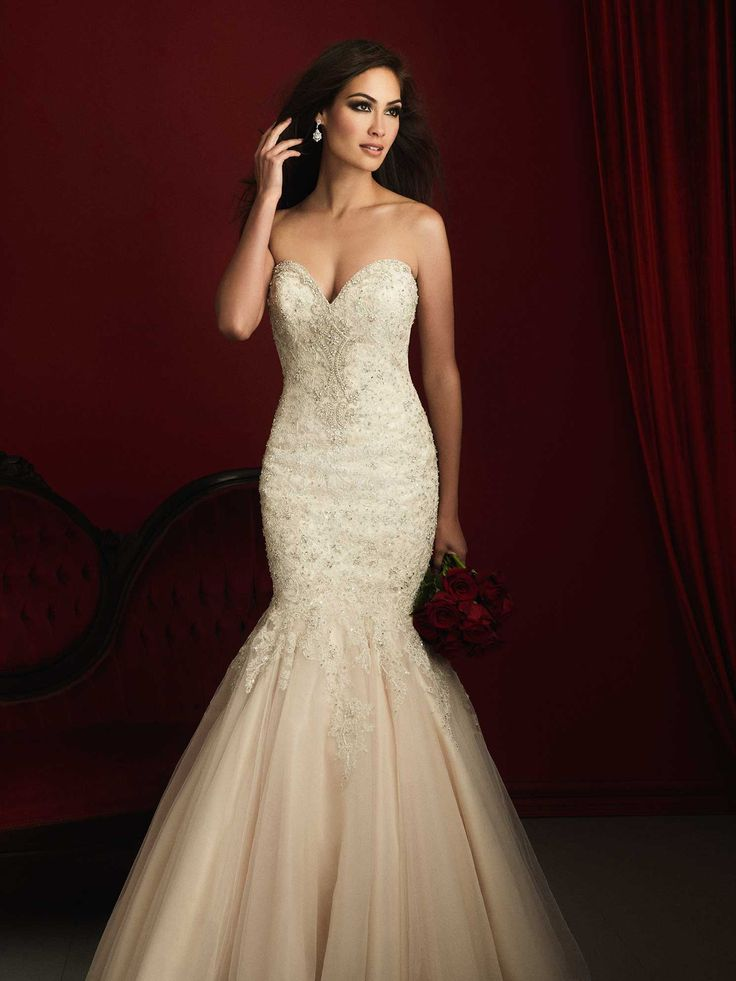 Allure Couture C363 Beading and delicate lace compose this strapless gown.