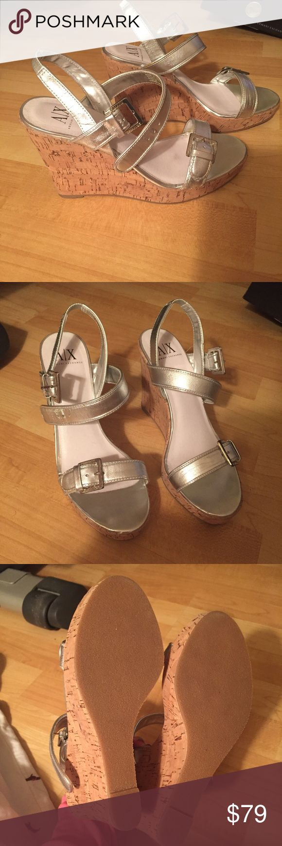 Armani Exchange wedges Never worn outside!!! Only walked around inside my home. Smells brand new!!! Comfortable and cute. Goes with jeans or a dress!!! Silver leather straps and silver buckles. They need a home where they will be worn. Make me an offer 💚 Armani Exchange Shoes Wedges