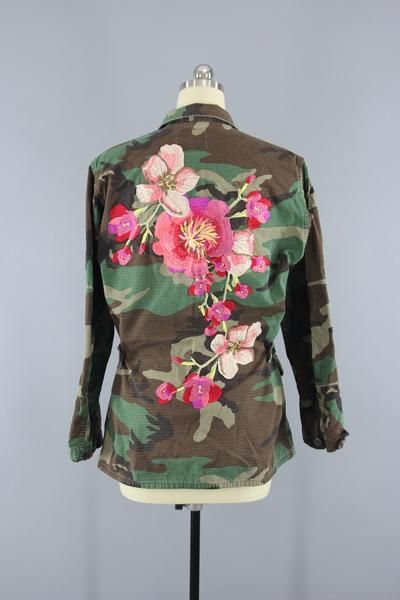 Awesome and completely one-of-a-kind, this 1989 US Army jacket has been enhanced with a very large peach pink floral embroidery patch. The jacket itself is made