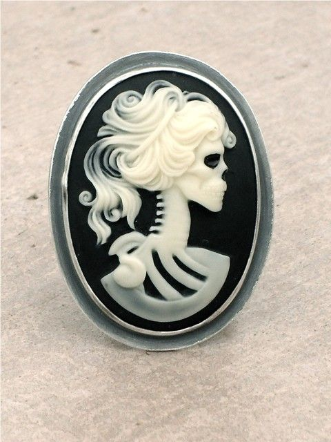 Sterling Silver Steam Punk Cameo Ring. Creepy - but I love the twist on the traditional.