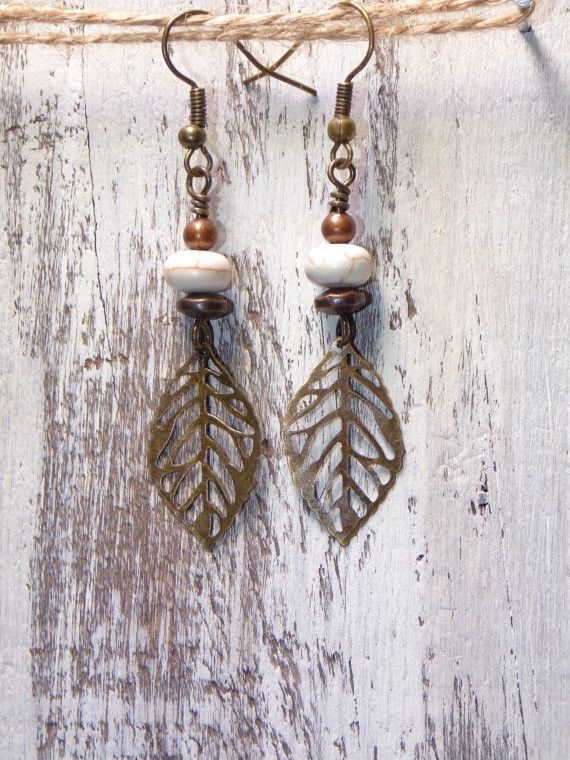 Mixed metal earrings ~brass leaves ~white turquoise ~copper accents ~brass fish hook earwires Measures 2 1/2 inches from top of earwire