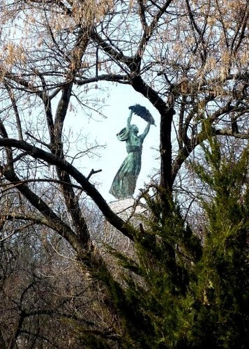 A sneaky view of the Statue of Liberty through the trees in Budapest, Hungary. Gellért Hill upon which the citadel stands, has many paths through the woods and makes a lovely walk, especially in the heat of summer.