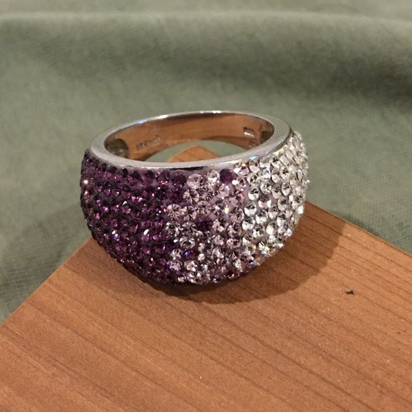 Bling! sterling dome ring with SWAROVSKI crystals Bling! Sterling silver dome ring embellished with graduating ombre shades of purple, pink-lavender and white SWAROVSKI elements crystals.  Marked 925 (see photos) and approx a size 8. In excellent condition with all stones intact. Please ask any questions you may have before purchasing. 🚫Trades, 🚫Low ball offers please. Swarovski Jewelry Rings