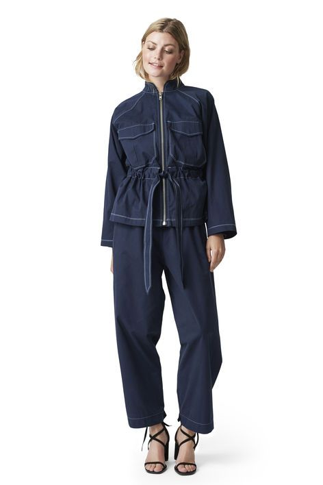 Loose fitted jacket with large pockets, visible  front zip and a detachable waist belt. <br /><br />Model is  175cm tall and wearing a size small/ 36.