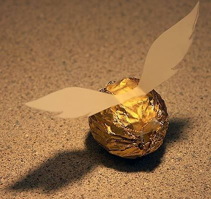 Snitch made from ferrero rocher chocolates-geez where was this idea when I had Simons Harry Potter party a couple of years ago.