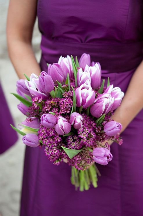 Purple Wedding Inspiration: A cluster of tulips and small wild flowers makes a dreamy bridesmaid bouquet. www.colincowiewed...