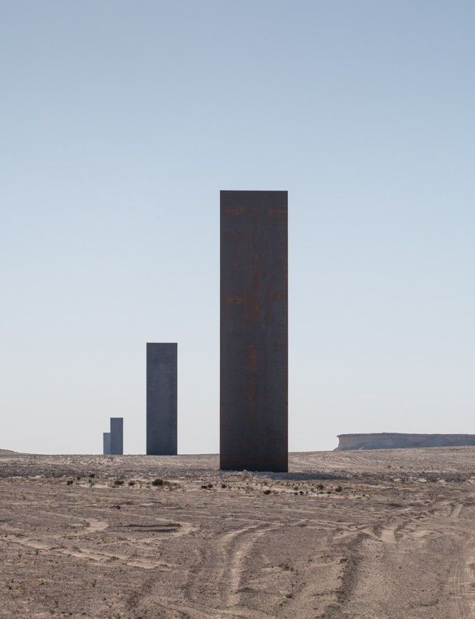 Richard Serra's | East-West/West-East — a permanent sculptural installation in Qatar's desert, approximately 60 kilometers from Doha at the Brouq Nature Reserve.