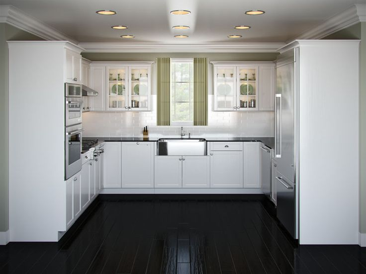 black and stainless kitchen like white cabinets black countertops and wood floors and stainless steel appliances