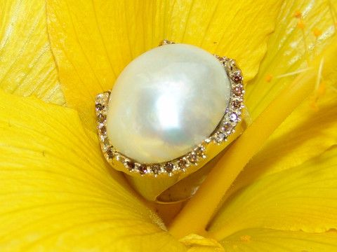 South Sea Mother of Pearl ring warped in Cognac diamonds and whit gold set in Sterling Silver, by Georgina Whitford.