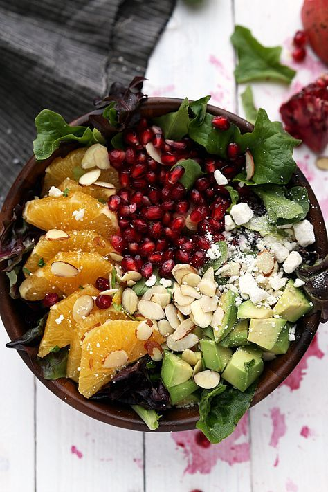 A delicious and healthy salad perfect for winter or a special Christmas dinner. This salad is topped with fresh oranges, pomegranate arils, sliced almonds, chopped avocado, and feta cheese. Christmas dinner salad anyone?! This one is already on our Christmas dinner menu. Oh, and probably on our dinner menu for every-night until Christmasbecause YUM. Okay...
