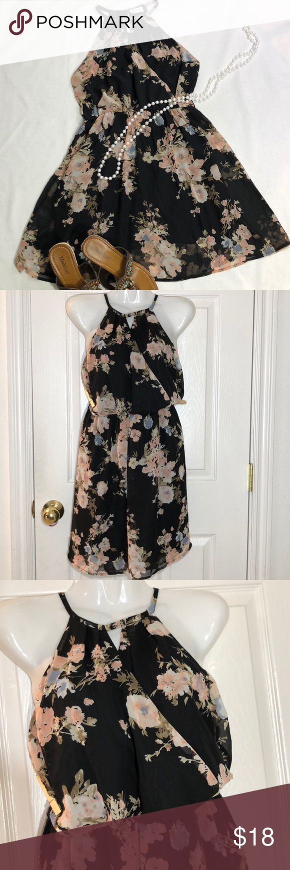 """Sienna Sky Sleeveless High Neck Flowy Flower Dress Great pre owned normal wash wear condition Sienna Sky flowy black sheer flowery dress with built in slip. Size medium. Measurements; chest 16"""" waist (elastic unstretch) 13.5"""" length (top collar to hem)  31"""". Smoke and pet free home. sienna Sky Dresses"""