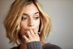 Caitlin FitzGerald, truly beautiful I love it how the elegance of her look is all about simplicity and nobleness. Her top can't actually be seen in this photo but what is seen gives me an impression of smart and plain basic clothing. The rings are charming as well.