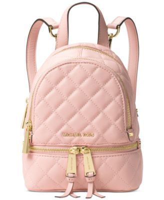 """Top-of-the-class style abounds with Michael Michael Kors' chic quilted leather messenger backpack. 