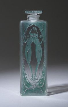 "LALIQUE ""Lepage"" perfume bottle, circa 1920, in clear and frosted glass with green patina. Molded R. LALIQUE, engraved France (liveauctioneers.com)"
