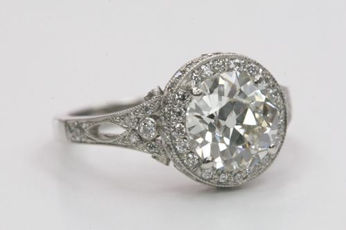 ❦ 2.01-carat old European-cut diamond set in a platinum Single Stone halo setting with European-cut accent diamonds