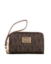 MK wallet that has a pocket for your iphone too! i want thissss  b day present?=] mom and daddd