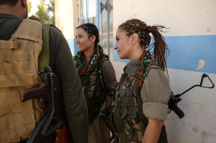 Zekia Karhan, 26, right, and Felice Budak, 24, middle, speak with a journalist in Makhmur, Iraq, Aug. 23, 2014. Karhan and Budak are guerrillas in the Kurdistan Workers' Party.