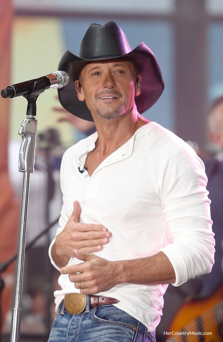 Tim McGraw in concert. Damn! Tour dates, cities, Tim McGraw tictets, etc. at HerCountryMusic.com