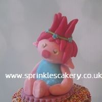 A 100% edible Princess Poppy to sit on top of a colourful 2 tier cake.