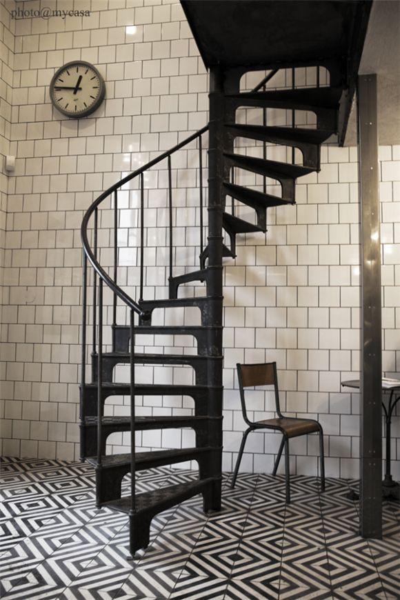 Black and white tiled floor, white tiled walls, spiral staircase | monochrome | interior decor | design | interiors