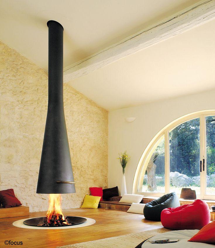 #cheminee filiofocus télescopique  foyer central ouvert à bois, avec une hotte télescopique #design contemporain