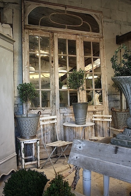 Vintage old European doors with mirrored panes take you back in time.... would love to have a potting shed like this!
