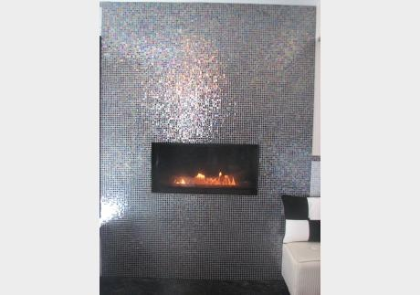 Stunning fireplace in iridescent mosaic glass tile.