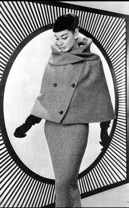 1956 Jacky Mazel is wearing tweed suit with short cape instead of jacket by Lanvin-Castillo