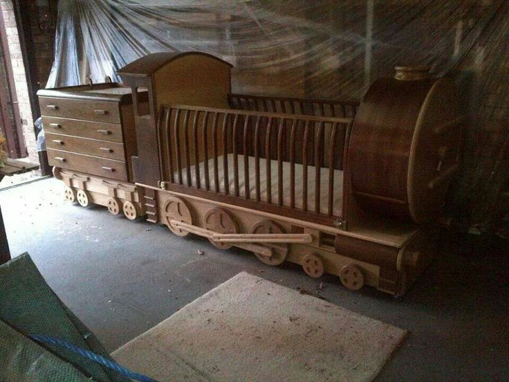 Beautiful wooden train baby crib with drawers and changing table