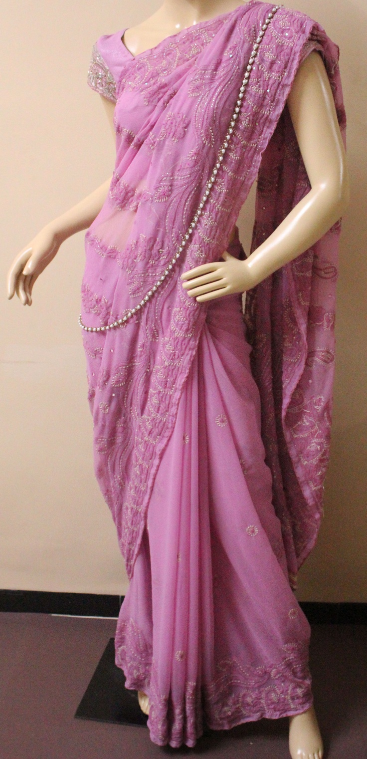 lucknowi embroidery <3 love the color and the strand of pearls as an accessory.