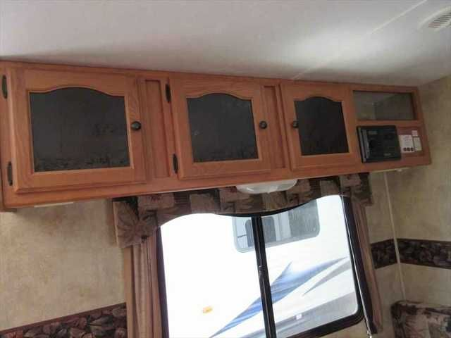 2009 Used Keystone Passport Ultra Lite Travel Trailer in Virginia VA.Recreational Vehicle, rv, 2009 Keystone Passport Ultra Lite , Lightweight trailer with a slide out room! Fiberglass exterior, aluminum frame, ducted roof a/c, patio awning, stabilizer jacks, 2 rear bunks, radio, outside speakers, TV antenna, sleeps 7, weighs only 4,990 lbs!,