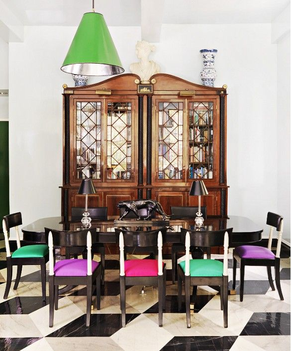 traditional cupboard + colorful chairs