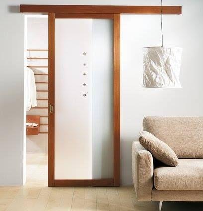 Puerta corrediza marco madera con vidrio