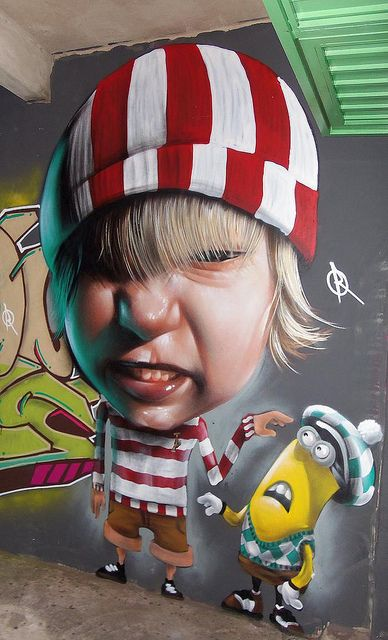 Brazilian Street Art artist Sipros. I would love to do this with Brody's picture since he loves minions!!! :)