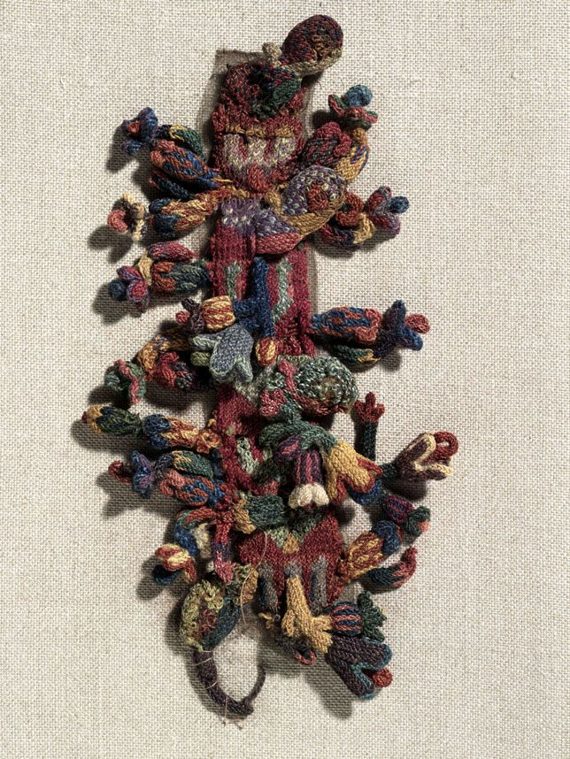 Border fragment Peruvian Cross-knit loop stitch embroidery in wool Centimetres: 17 (length), 9 (width) 0 – 300 Pre-Columbian; Early Horizon; Early Nazca Area of Origin: Nasca, Peru Patricia Harris Gallery of Textiles & Costume 931.12.30 ROM2008_9755_1