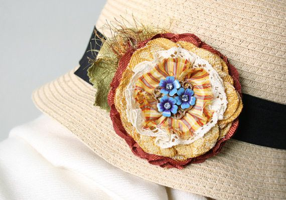 Description A whimsical accessory to jazz up any item in your wardrobe all year round. This everlasting flower pin features layers of hand cut and sewn fabrics in golden yellows, green and copper oran
