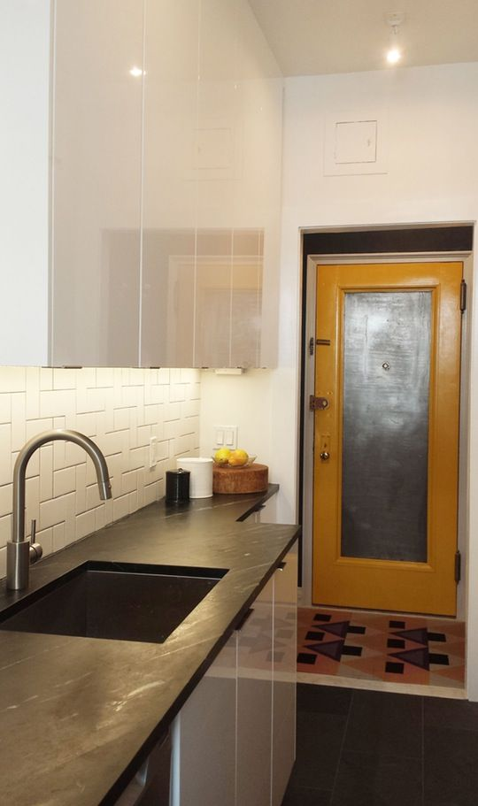 """Nathan Rittgarn doesn't list the square footage in his professional project submission of this kitchen, located in a pre-war Brooklyn Heights one-bedroom apartment. But you can see from the before photos above, it's not particularly expansive. Coupled with the fact that the apartment's """"entryway"""" dumps you right in front of this small space, and it's clear this room needed an update not just for aesthetics, but for function, too."""