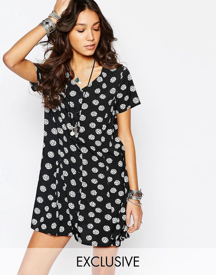 Buy it now. Reclaimed Vintage Button Front Swing Dress In Spotty Spot - Black. Dress by Reclaimed Vintage, Lightweight woven fabric, V-neckline, Button through front, Swing shape, Relaxed fit, Machine wash, 100% Polyester, Our model wears a UK 8/EU 36/US 4 and is 175cm/5'9 tall, Products vary due to reclaimed nature, Exclusive to ASOS. ABOUT RECLAIMED VINTAGE Reclaimed Vintage is a limited-edition collection made from vintage fabrics and up-cycled original vintage pieces. The Reclaimed team…