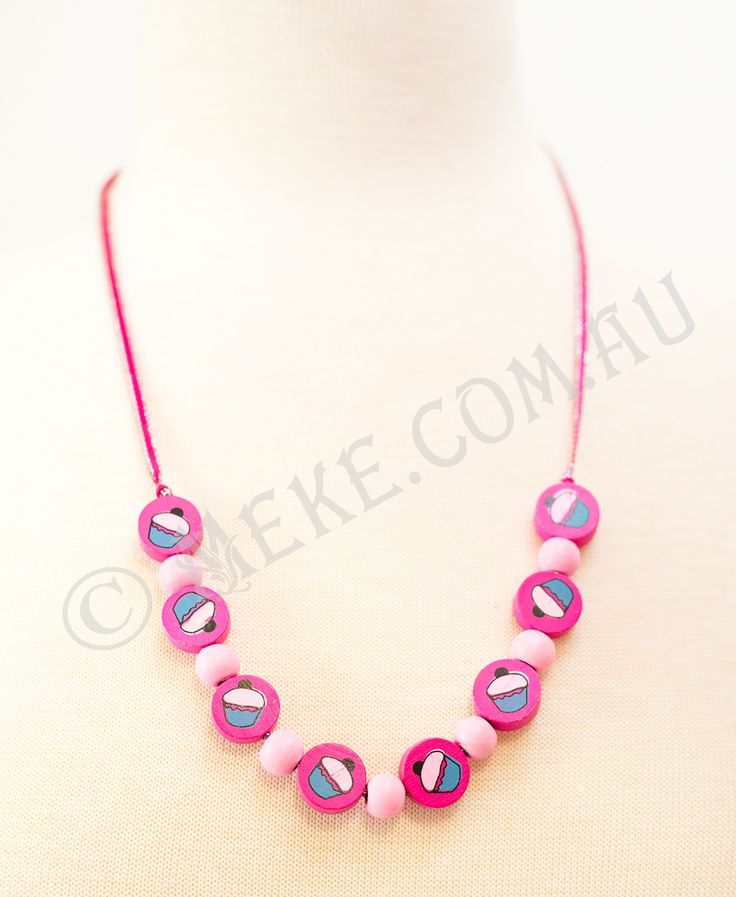 : : Cupcake Cutey Necklace : :  Your little cutey will look adorable in this handcrafted children's necklace featuring bright pink timber cupcake feature beads and baby pink round timber beads on a matching dainty pink and silver ribbon. Too cute!!! Visit my Etsy store for more info, or to purchase: https://www.etsy.com/au/listing/153869205/cupcake-cutey-childrens-necklace-bright?ref=related-0  Handmade with love and care by Marianne ❤