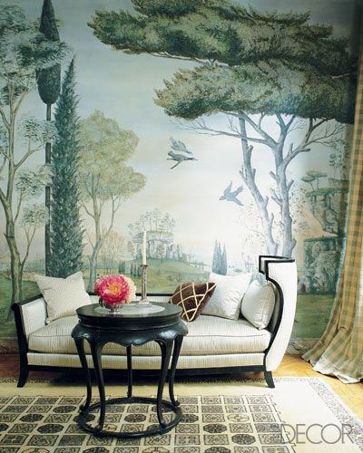 """The dining room of designer Rose Anne de Pampelonne's Beaux Arts mansion in Paris is adorned with murals inspired by landscapes in Renaissance paintings. Besides scenes of birds and trees, they include profiles of her children and portraits of family pets, adding a highly personal touch. """