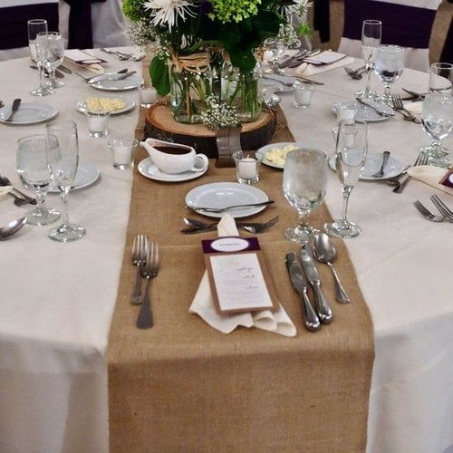 Hessian Table Runner On Round Table, White Table Cloth And Wildflowers.  Loves