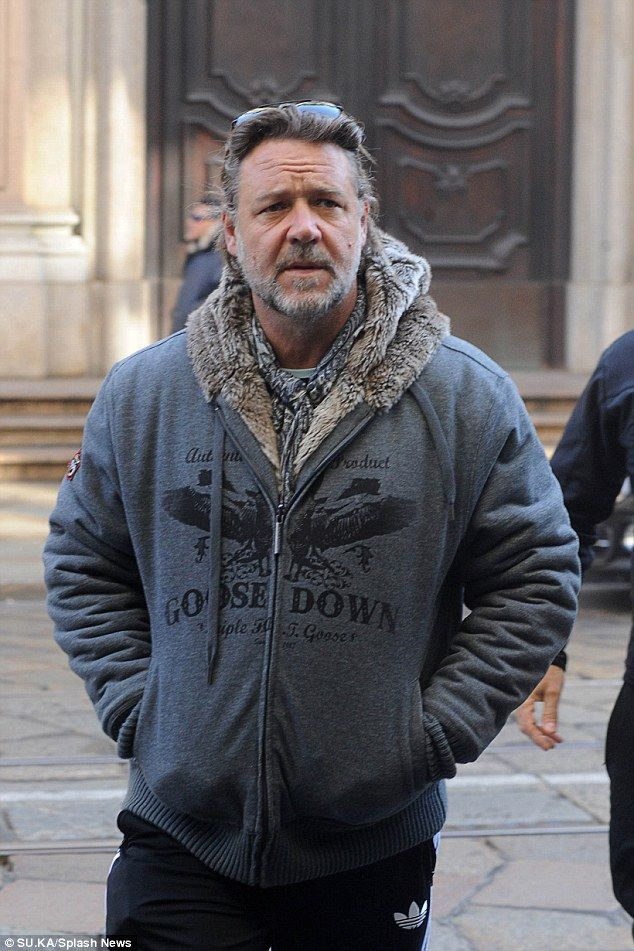 Wrapping up: The 51-year-old was sure to stay snug in a fur-lined knitted hoodie as he too...