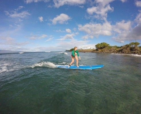 Surfer girl rides her first wave on Maui!