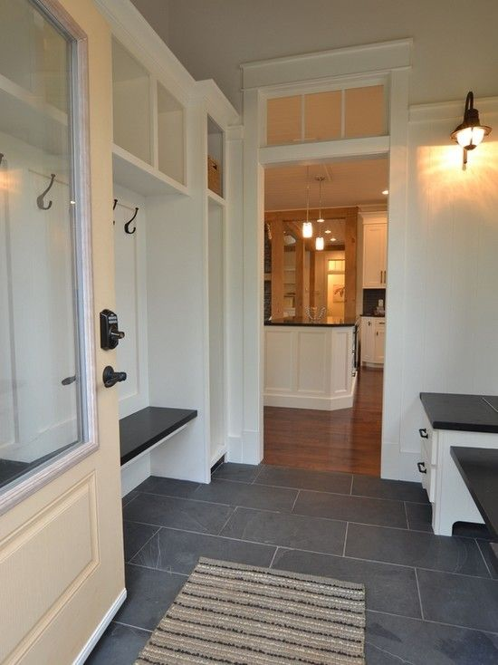 Durable, stylish flooring  for a mudroom. Love the transome window and big window in the door.