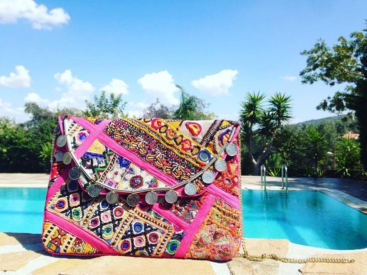 This beauty is handcrafted by our artisans in India using vintage tribal embroidery. Shop our best-selling pink clutch online on be-snazzy.com #bohochic
