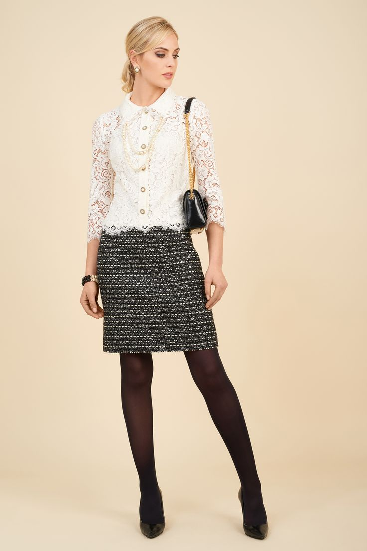 Lace dress with skirt in bouclè fabric and Isole bag.