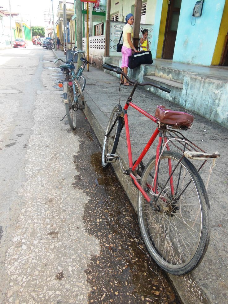 Bicycles everywhere! I loved the narrow, tight line and the shadow that lends perspective. It wouldn't work for me without the waiting woman and girl. Lots to think about when snapping photos -- but it is easy in Baracoa. Join James and me for our writing and photographic workshop in early 2015 (www.travelnotebook.ca). Photo by Kathryn MacDonald©