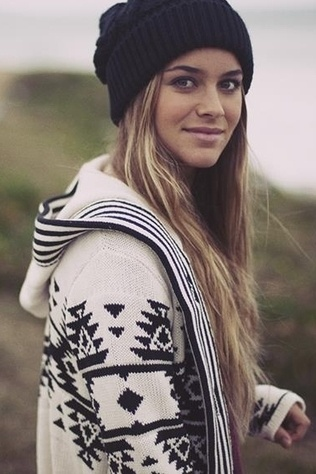 Sweater and hat. and she has a really happy/nice smile.